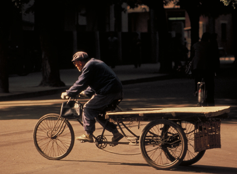 Gone are the deserted streets, the bicycles and people strolling lazily along. Being today is a city that moves fast, filled with six lane streets with cars whizzing in every direction. Photo: Dan Stroud/Newsroom Ink