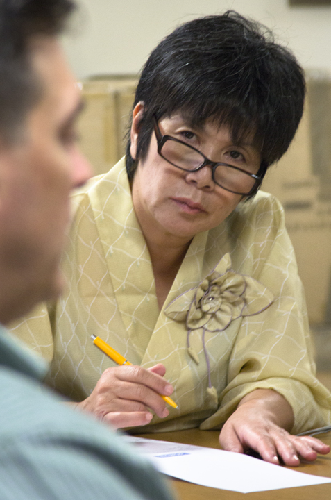 Akiko Iwasaki, proprietor of the Houraikan Resort on the east coast of Japan, listens to Smith tell the tale of disaster after disaster faced by the Louisiana seafood industry. Photo: Ed Lallo/Newsroom Ink